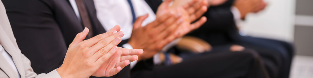 Happy customers applauding a successful consulting project