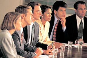 Leadership team listens to internal consultant's presentation