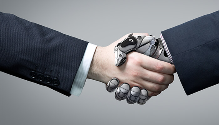 Graphic of a human shaking hands with their technology support