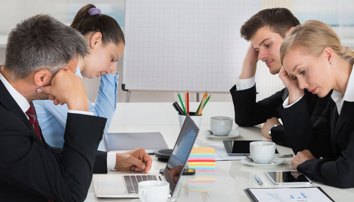 Image of a Project Team Realizing they have caused negative side-effects.